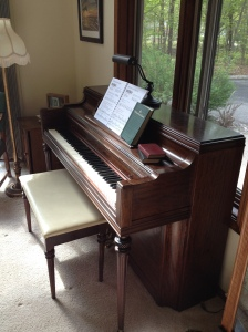 My mom's piano in my home.